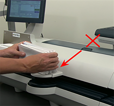Stack of envelopes being aligned on the machine