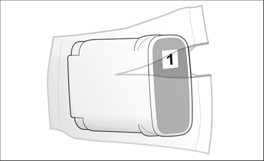 Image showing the new ink cartridge being removed from its packaging