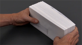 Tapping the envelopes on a flat surface