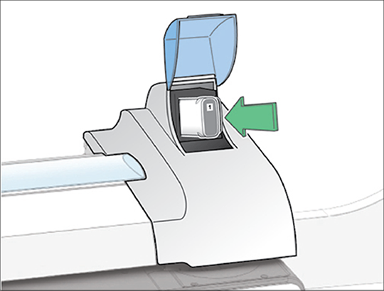 Image showing the new ink cartridge being installed